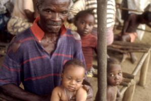 Old man and grandchild in Memieh Town, Liberia.