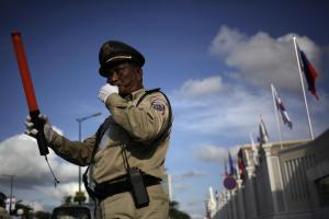 Police officer regulating traffic in Phnom Penh: the government is preparing new rules to define how state and citizens interact