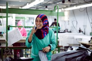 Worker producing eco-jeans in a Tunisian factory.