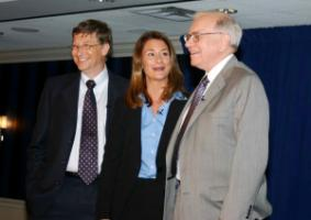 Bill and Melinda Gates with Warren Buffett, who has also pledged billions to the Gates Foundation.
