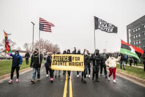 Protesters march in the Minneapolis suburb where, on 11 April 2021, a police officer killed Daunte Wright, a young Black man.