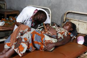 Underfunded health-care systems: a doctor examining a pregnant woman in Congo-Brazzaville long before the pandemic.