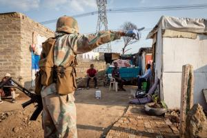 Not much scope for social distancing: a soldier enforcing South Africa's lockdown in a township.