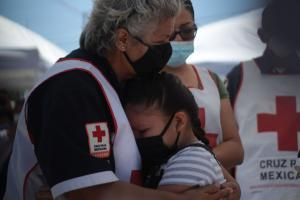 Mexico needs its care workers: Red Cross nurse grieving at the funeral of a colleague who died of Covid-19.