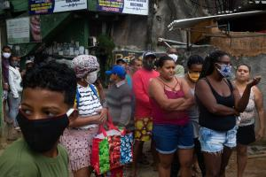 Not much space for social distancing: favela residents waiting for food supplied by a non-governmental activist.