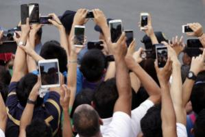 """""""Internet-service providers would turn into spies"""": smart-phone and tablet users preparing to take pictures of Pope Francis in Manila in January."""