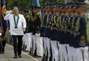 President Benigno Aquino saluting members of the Armed Forces of the Philippines in Manila.