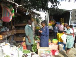 Informal grocer placing orders after Twiga delivery in Nairobi.