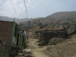 National circumstances matter: informal settlement in the Lima agglomeration