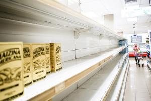 Empty supermarket shelves in Caracas in January.