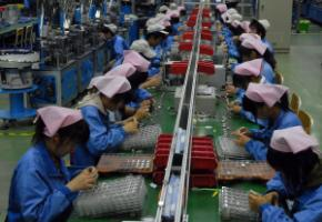 Workers in a Foxconn factory in Huai'an in 2009.