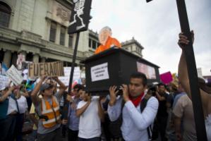 """The downfall of a military regime"": Activists with a symbolical coffin for President Molina's government."