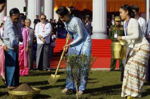 Aung San Suu Kyi planting a tree during the opening ceremony of  the National Reconciliation and Peace Center in January in Naypyitaw, Myanmar.