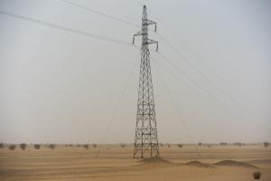 Infrastructure is vital for economic development: electricity pylon in the Sahara.
