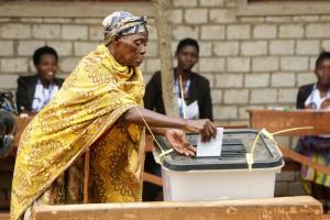 A Burundian citizen casts her vote.