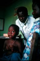 A doctor examining a child at a hospital on the outskirts of Cotonou.