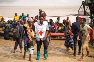 Cyclone Idai survivors rescued in boats to Beira, Mozambique, which had also been largely devastated.