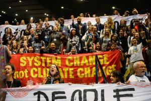 Demanding system change to stop global warming: rally at the UN climate conference in Katowice.