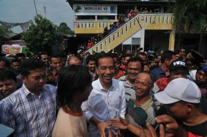 Supporters greet president-elect Joko Widodo (centre) in Surabaya in late July.
