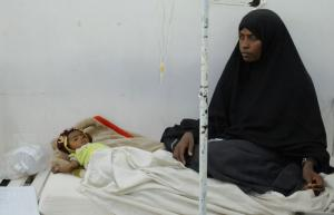 The war in Yemen causes a humanitarian crisis: a mother sits by her malnourished child at a therapeutic feeding centre in Sanaa.
