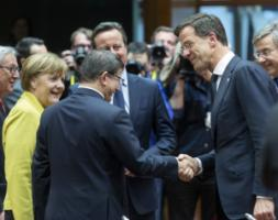 National leaders smiling in Brussels on 18 March: Angela Merkel (Germany), Ahmet Davutoglu (Turkey), David Cameron (Britain) and Mark Rutte (Netherlands).