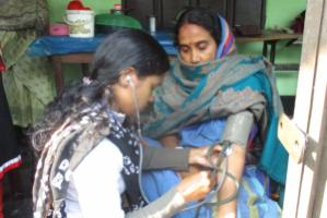 Paramedic providing antenatal and postnatal care on behalf of GK in a village.