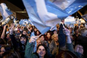 Supporters of Alberto Fernández celebrate his victory in the preliminary election.