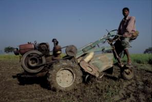 Smallholdings must become more productive: Bangladeshi farmer with a motorised plough.