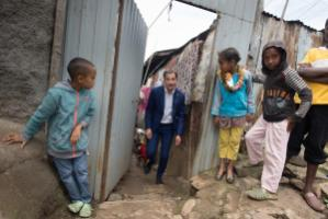 Alexander de Croo, Belgium's minister for international development, visits a disadvantaged neighbourhood during the summit in Addis.