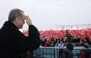 Erdogan salutes supporters in late 2016.