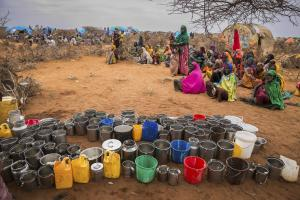 Women and children wait for water in Ethiopia during drought.