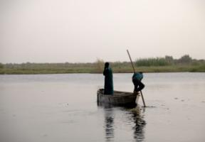 A fisher and his son on Lake Chad in Chad.