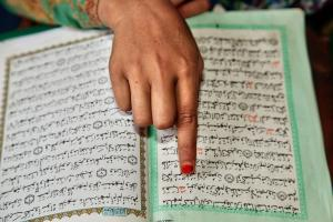 Muslim girl reading from the Quran at a Madrassa.