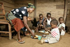 A grandmother in Cameroon taking care of AIDS orphans.
