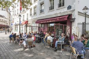 A café on the Place des Abesses, similar to many cafés where Parisians enjoyed their evening on 13 November 2015.