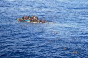 Refugees in a boat on the Mediterranean Sea.
