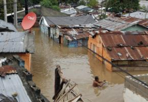 The poor are the most vulnerable: a flooded informal settlement  hit by Hurricane Sandy in Santo Domingo in October 2012.