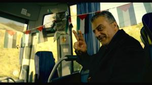 The manager of the Palestinian team, played by Norman Issa.