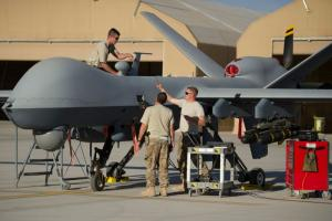 Soldiers doing maintenance work on  a US Air Force Drone in Kandahar, Afghanistan in December 2015.