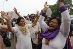 Many people celebrated the judgement: women in Delhi.
