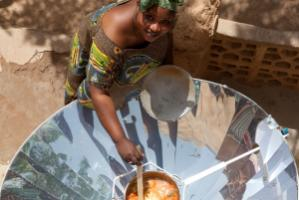 Many trees could be saved if all people used solar cookers instead of wood or coal like this woman in Mali.