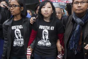 Domestic worker Erwiana Sulistyaningsih (center) from Indonesia was brutally abused by her Hong Kong employer who is now serving a six-year jail sentence.