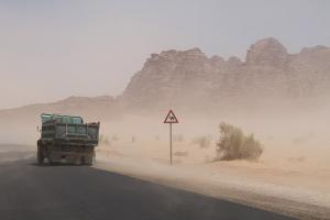 Road traffic presents many hazards; in Jordan, these include sandstorms and camels.