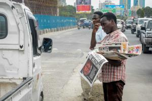 Too many people cannot read: newspaper vendor in Dar es Salaam in March 2021.