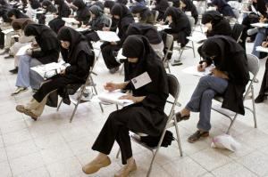 More than half of Iran's students are female: young women taking an exam in Tehran in 2003.