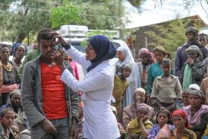 Mobile health workers educate rural villagers in Ethiopia on trachoma, a disease caused by bacteria that leads to a loss of eyesight if left untreated.