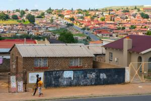 The township of Soweto, Johannesburg, with low-income housing in the foreground and more affluent suburbs in the background.