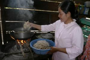 A woman cooking at home in Cambodia's Stung Treng District.