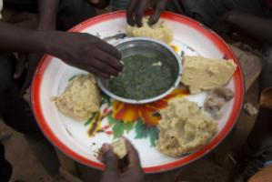 Conflict causes hunger: displaced persons having lunch in the Central African Republic last year.