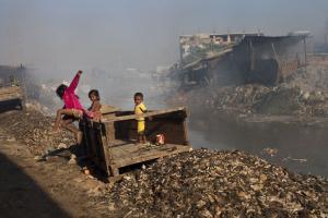 A clean environment is a public good: children playing in a neighbourhood polluted by emissions from the leather industry in Dhaka, Bangladesh.